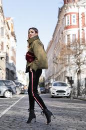 jacket,tumblr,green jacket,bomber jacket,puffer jacket,pants,black pants,side stripe pants,high heels,heels,peep toe heels,bag