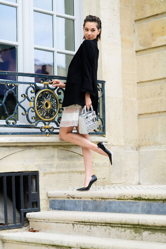 jacket fashion week street style fashion week 2016 fashion week paris fashion week 2016 black blazer dress white dress white lace dress lace dress bag silver bag dior dior bag pumps pointed toe pumps high heel pumps black pumps shoes streetstyle