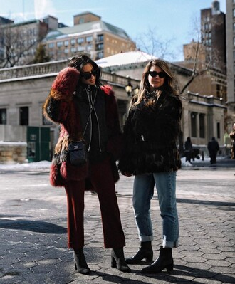 coat tumblr red coat fur coat faux fur coat pants red pants cropped pants boots black boots high heels boots jacket black jacket black leather jacket leather jacket bag mini bag denim jeans blue jeans fur jacket faux fur jacket sunglasses fashion week 2017 fashion week streetstyle nyfw 2017