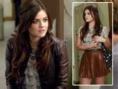 skirt,lucy hale,aria montgomery,pretty little liars,brown skirt,leather skirt,leather jacket,pleated skirt,blouse,shirt,jacket,t-shirt,skull t-shirt,skull,brown,worn on tv,cute