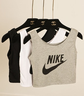 top,balck and grey,crop tops,nike,black and white,crop tanks,grey,sportswear,tank top,t-shirt,nike top,this,tick,tik,yum,chanel inspired,hanger,channel hanger,nike air,sporty,shirt,nike high tops,white,nike crop top,nike shirts,nike sports bra,crop top nike,chanel,adidas,nike cropped top,nike tank top,black,gray nike logo,black nike logo top,white tank top,cropped,nike sweater,lit,retro,black white gray,crop tank