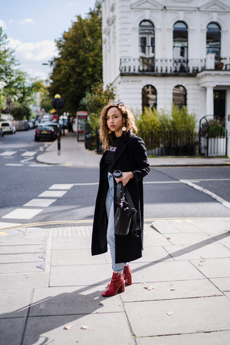 a style diary blogger coat t-shirt jeans bag shoes jewels fall outfits red boots ankle boots black coat tumblr black t-shirt denim blue jeans cropped jeans boots sunglasses