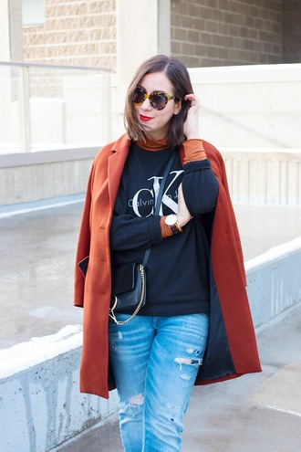 adventures in fashion blogger sweater coat jeans bag shoes sunglasses jewels chloe faye bag chloe bag black bag crossbody bag rust winter coat tortoise shell sunglasses tortoise shell sweatshirt black sweatshirt blue jeans ripped jeans sports sweater