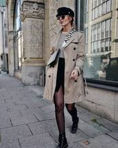 bag,shoulder bag,black bag,coat,trench coat,boots,tights,mini skirt,wrap skirt,black skirt,striped t-shirt,cap,sunglasses