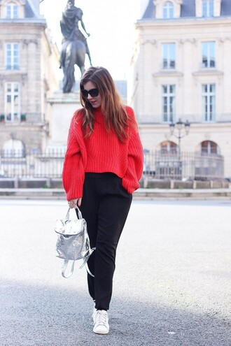 elodie in paris blogger black pants knitted sweater red sweater holographic backpack