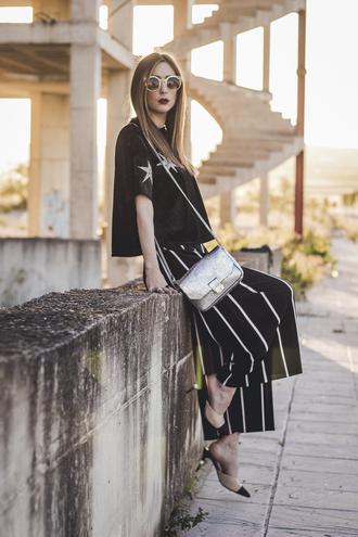 shoes and basics blogger t-shirt pants bag shoes sunglasses black top black pants wide-leg pants metallic bag spring outfits