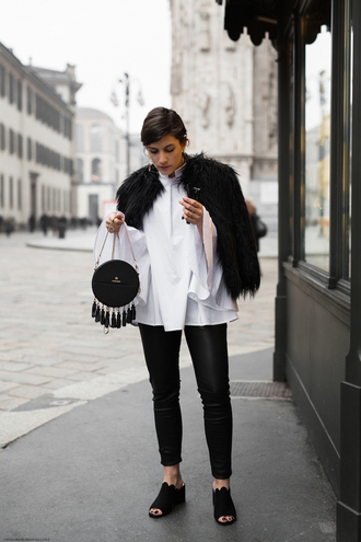 viennawedekind blogger jacket shirt pants jewels bag fur coat white shirt mules round bag winter outfits