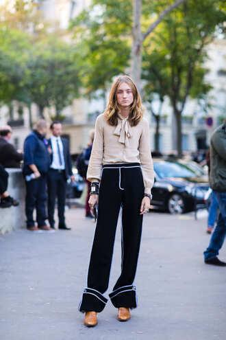 pants nude shirt fashion week street style fashion week 2016 fashion week paris fashion week 2016 black pants wide-leg pants shirt long sleeves shoes streetstyle