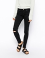 ASOS Whitby Low Rise Skinny Jeans in Washed Black With Ripped Knee at asos.com