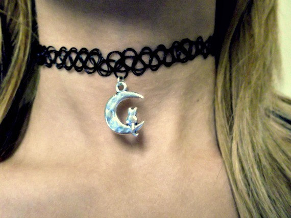 Silver cat on a crescent moon