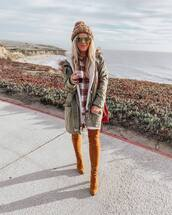 coat,womens parka,olive green,parka,brown leather over the knee boots,flannel shirt,knitted beanie,red bag,white jeans