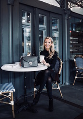 krystal schlegel,blogger,bag,skirt,shoes,tights,jewels,fall outfits,all black everything,black skirt,black bag,boots,ankle boots,black boots