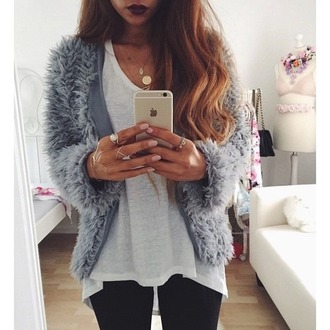 jacket iphone blue grey jacket hairy hairy jacket long hair jewels jewelry ring hand jewelry hand chain gold gold jewelry gold ring