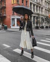 jacket,leather jacket,biker jacket,midi dress,ruffle dress,handbag,booties,leather boots,umbrella