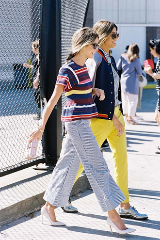 vanessa jackman blogger shirt blouse pants yellow pants stripes colorful clutch white heels wide-leg pants high waisted pants yellow bomber jacket