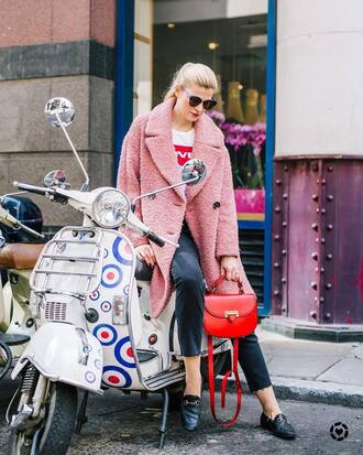 jacket pink jacket pants black pants handbag red handbag t-shirt white t-shirt loafers sunglasses blue sunglasses bag top shoes