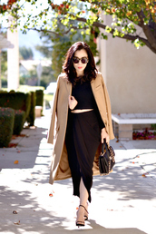 hallie daily,blogger,camel coat,draped,black skirt