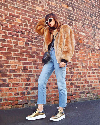 jacket tumblr fur jacket camel faux fur jacket denim jeans blue jeans cropped jeans shoes gold sneakers sneakers sunglasses white sunglasses