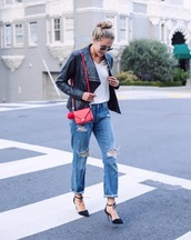 the classy cubicle,blogger,jewels,jeans,shoes,sunglasses,leather jacket,white,ripped jeans,boyfriend jeans,black heels,strappy heels,red bag