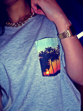 t-shirt clothes grey print palm tree baggy chain gold jewels shirt pocket t-shirt tree pockets summer hawaiian tropical pocket shirt spring palm trees pocket grey pocket palm tree sunset palm tree print orange yellow sunset black blue sun necklace watch palm blouse style palmier palms cool shirts grey t-shirt