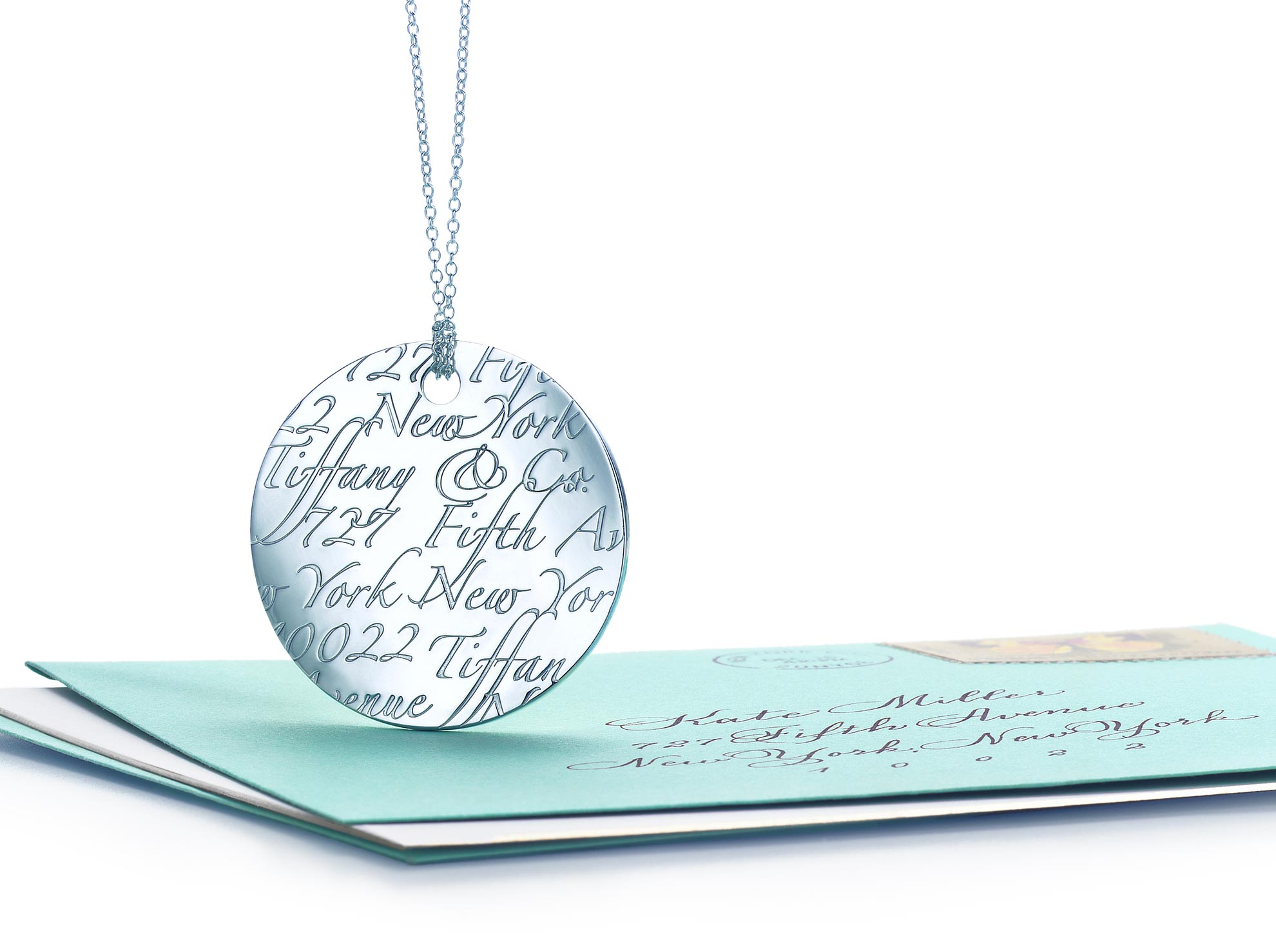 Tiffany Notes letter round pendant in 18k gold. Letters A-Z available.              