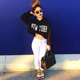 top shirt sweater crop tops black white jeans pants bag heela shoes gold cropped sweater new york hoodie denim handbag sunglasses lipstick jacket cropped hoodie bun make-up