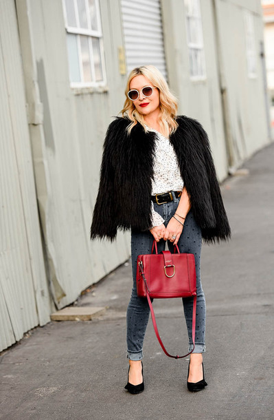 thehuntercollector blogger top jeans shoes coat bag sunglasses belt jewels red bag pumps winter outfits faux fur coat