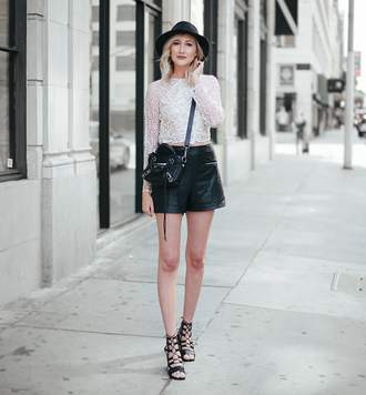 carly cristman blogger top shorts hat shoes blouse leather shorts black shorts mini bag black bag crossbody bag black hat sandals sandal heels black sandals lace up sandals white lace top lace top long sleeves crop tops white crop tops