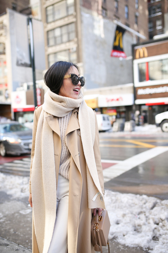 scarf nyfw 2017 fashion week 2017 fashion week streetstyle coat winter outfits winter look camel camel coat sweater beige sweater pants white pants bag boxed bag nude bag white and nude white and beige outfit monochrome outfit