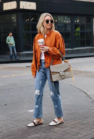 jacket tumblr orange orange jacket denim jeans blue jeans ripped jeans shoes white shoes sunglasses bag