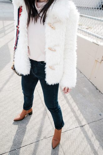 the fancy pants report blogger coat top jeans bag shoes fuzzy coat ankle boots faux fur jacket winter outfits fall outfits