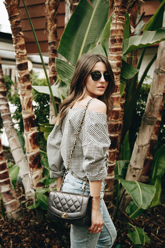 shirt tumblr off the shoulder off the shoulder top checkered shirt checkered bag black bag quilted bag sunglasses denim jeans light blue jeans three-quarter sleeves