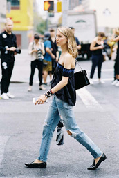 vanessa jackman,blogger,top,blouse,jeans,shoes,black off shoulder top,off the shoulder,off the shoulder top,cold shoulder,black top,black bag,ripped jeans,blue jeans,flats,black flats,loafers,black loafers