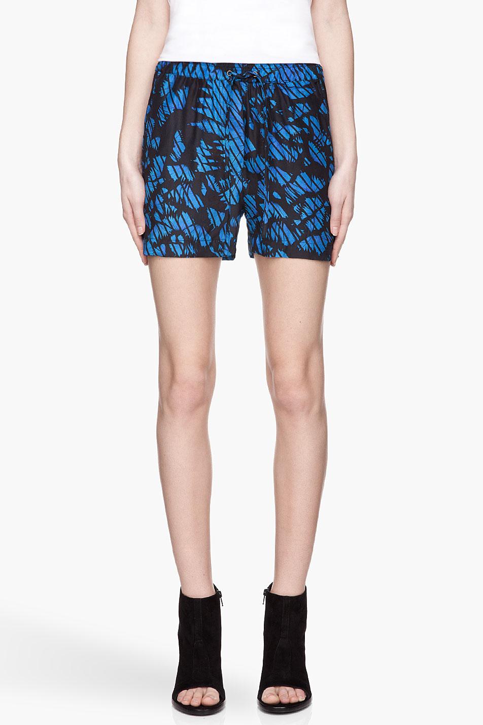 surface to air indigo blue leaves print cross silk shorts