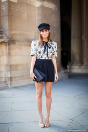 hat,black cap,white floral print shirt,black pleated skirt,yellow strappy sandals,blogger