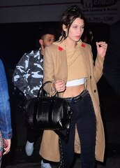 pants,coat,crop tops,cropped,cropped sweater,camel coat,camel,sweater,black pants,black jeans,beige coat,black bag,bella hadid,Bella Hadid Crop Top,lace up pants,top,denim,jeans,celebrity,model,bag,handbag,nude top,nude coat