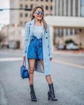 coat,blue coat,top,blue top,blue shorts,boots,sunglasses,bag,shorts,monochrome outfit,lace up
