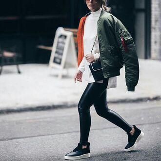jacket tumblr bomber jacket khaki bomber jacket green bomber jacket leggings black leggings leather leggings sweater white sweater slip on shoes bag black bag pants