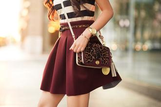 skirt burgundy pleated skater bag belt t-shirt watch fashion