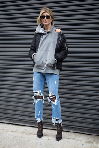 jeans nyfw 2017 fashion week 2017 fashion week streetstyle denim blue jeans ripped jeans tights pumps pointed toe pumps high heel pumps black heels hoodie grey hoodie jacket black jacket bomber jacket black bomber jacket sunglasses