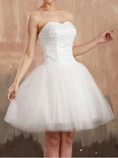 White strapless beaded dress with lace panel
