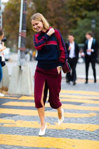 skirt fashion week street style fashion week 2016 fashion week paris fashion week 2016 red skirt slit skirt burgundy burgundy skirt midi skirt hoodie athleisure blue top bag streetstyle shoes white shoes pointed toe
