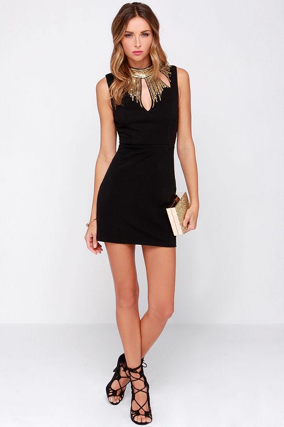 Queen of sequin black and gold sequin dress
