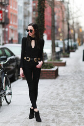 the glam files,blogger,all black everything,black sunglasses,black jeans,black top,black and gold belt,double buckle belt,black belt,bell sleeves,bell sleeve top,boots,black boots,black bag,long sleeves,fall outfits,high heels boots,pointed boots,bell sleeve sweater