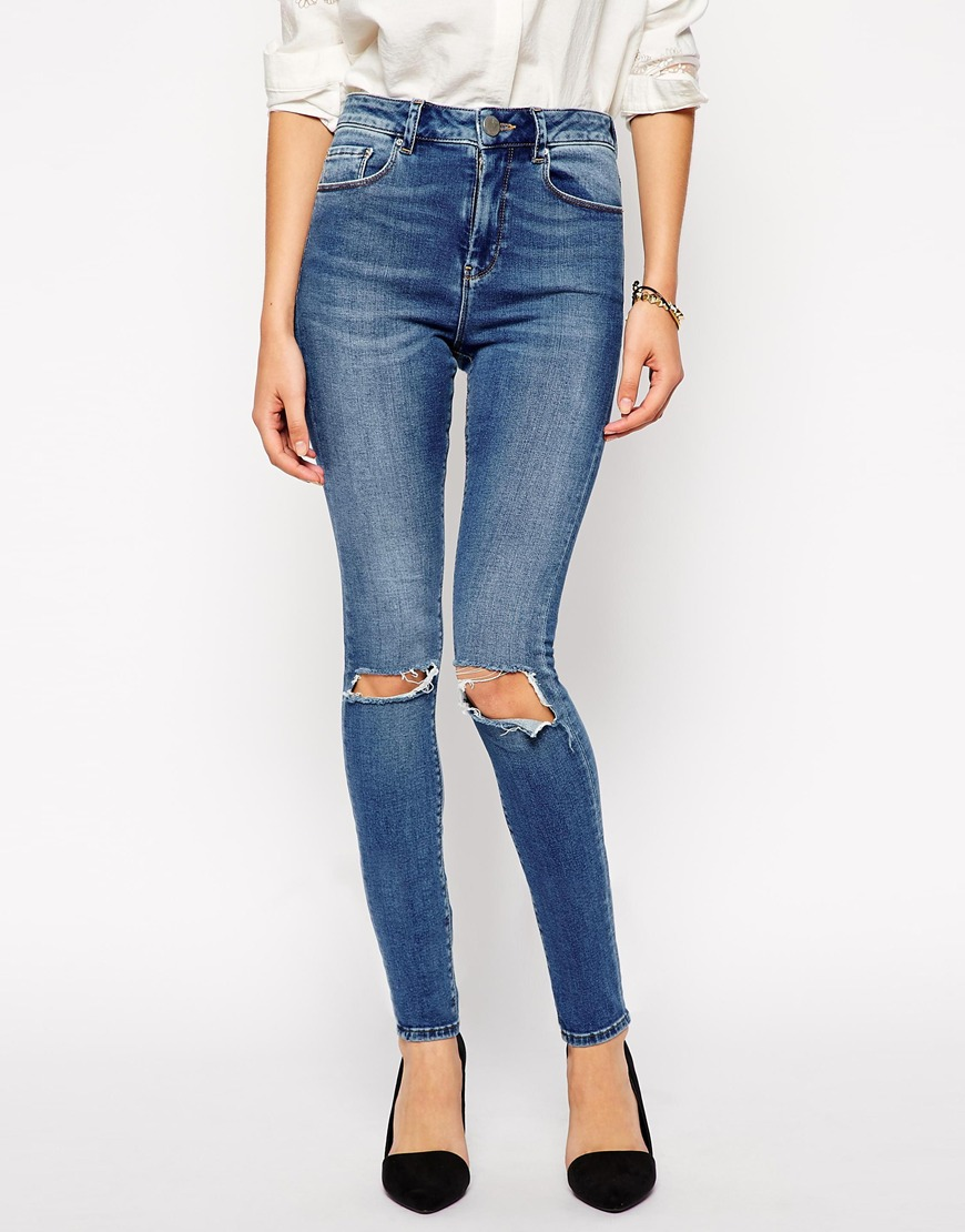 ASOS Ridley Skinny Jeans in Busted Mid Wash Blue with Busted Knees at asos.com