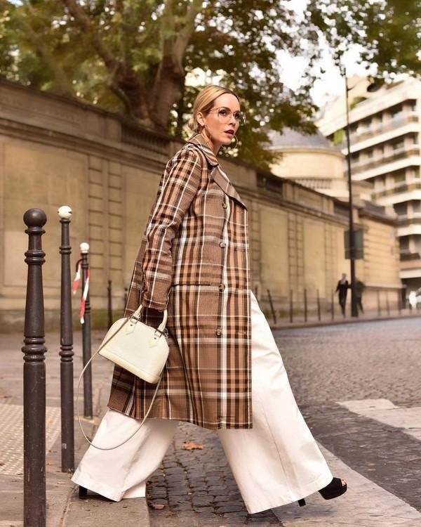coat checkered oversized coat wide-leg pants platform sandals handbag sunglasses earrings