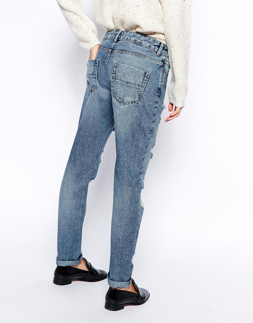 ASOS Brady Low Rise Slim Boyfriend Jeans in Mid Wash with Extreme Rips at asos.com