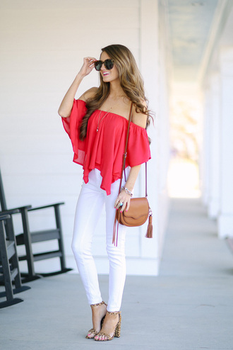 southern curls and pearls blogger jewels off the shoulder red top flowy sunglasses shoulder bag mini bag white jeans animal print
