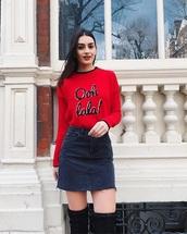 sweater,red sweater,denim skirt,quote on it,skirt,mini skirt