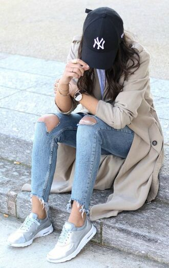hat black cap cap baseball cap coat trench coat nude coat jeans blue jeans ripped jeans sneakers silver sneakers black baseball hat